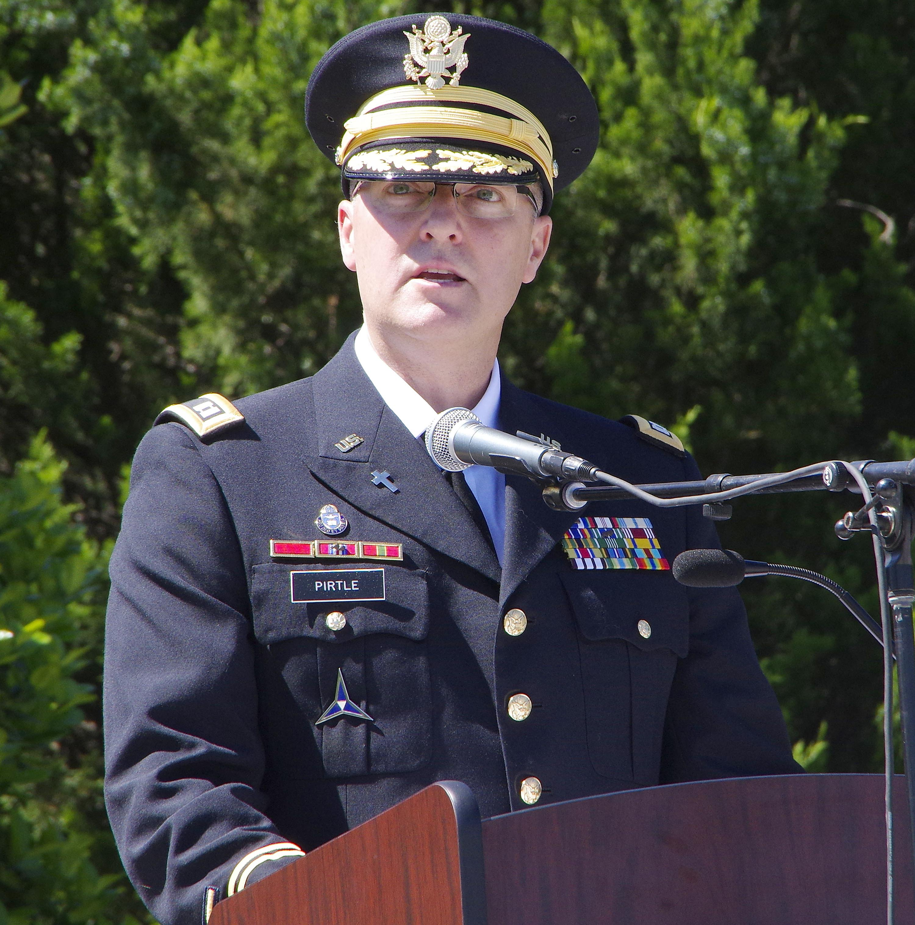 Chaplain CPT Jon Pirtle speaks before giving the invocation