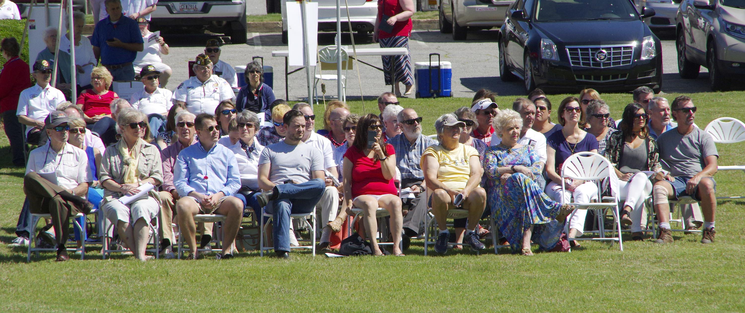 Families watch as the Avenue of Flags dedication begins