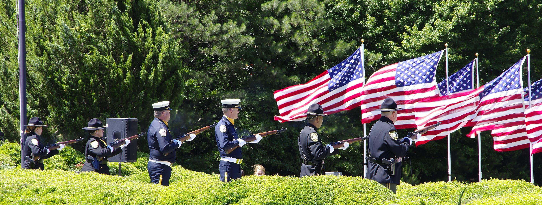 The honor guard fires a 21-gun salute.