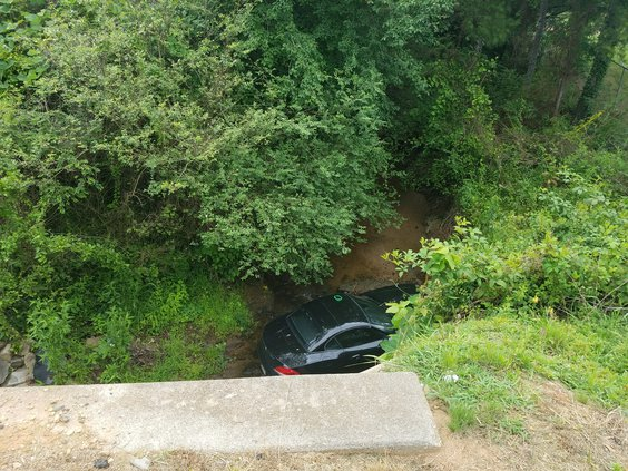 Car flies into creek