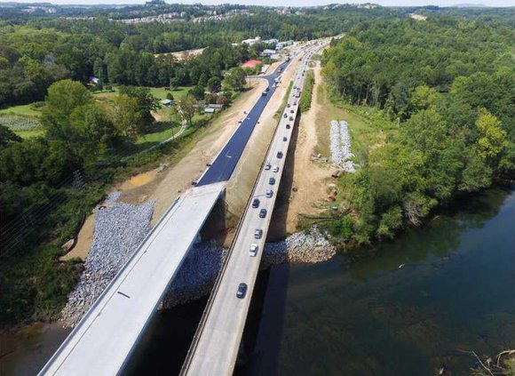 An aerial view of the old and new Hwy. 20 bridges over the Chattahoochee River shows the new one on the left has shoulders and is higher than the original bridge built in 1947.