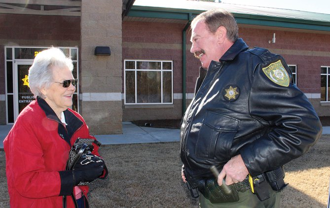 Deputy Jon Beival chats with a resident