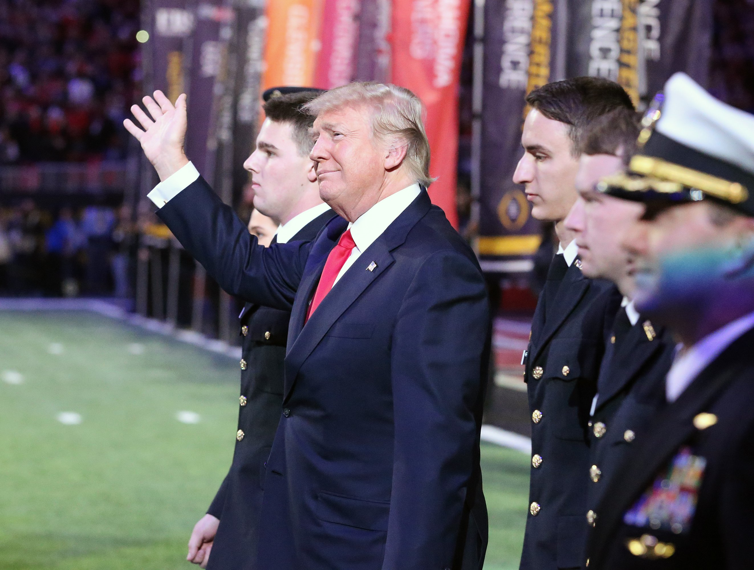 U.S. President Donald J. Trump enters the field for the national anthem