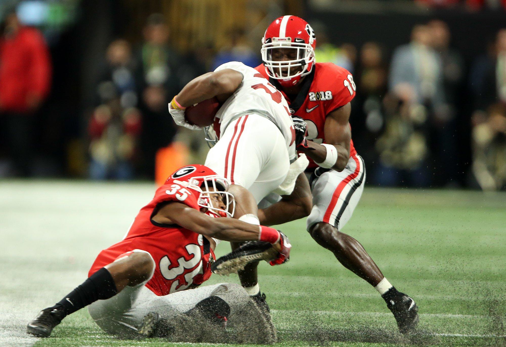 Georgia's Aaron Davis makes a tackle