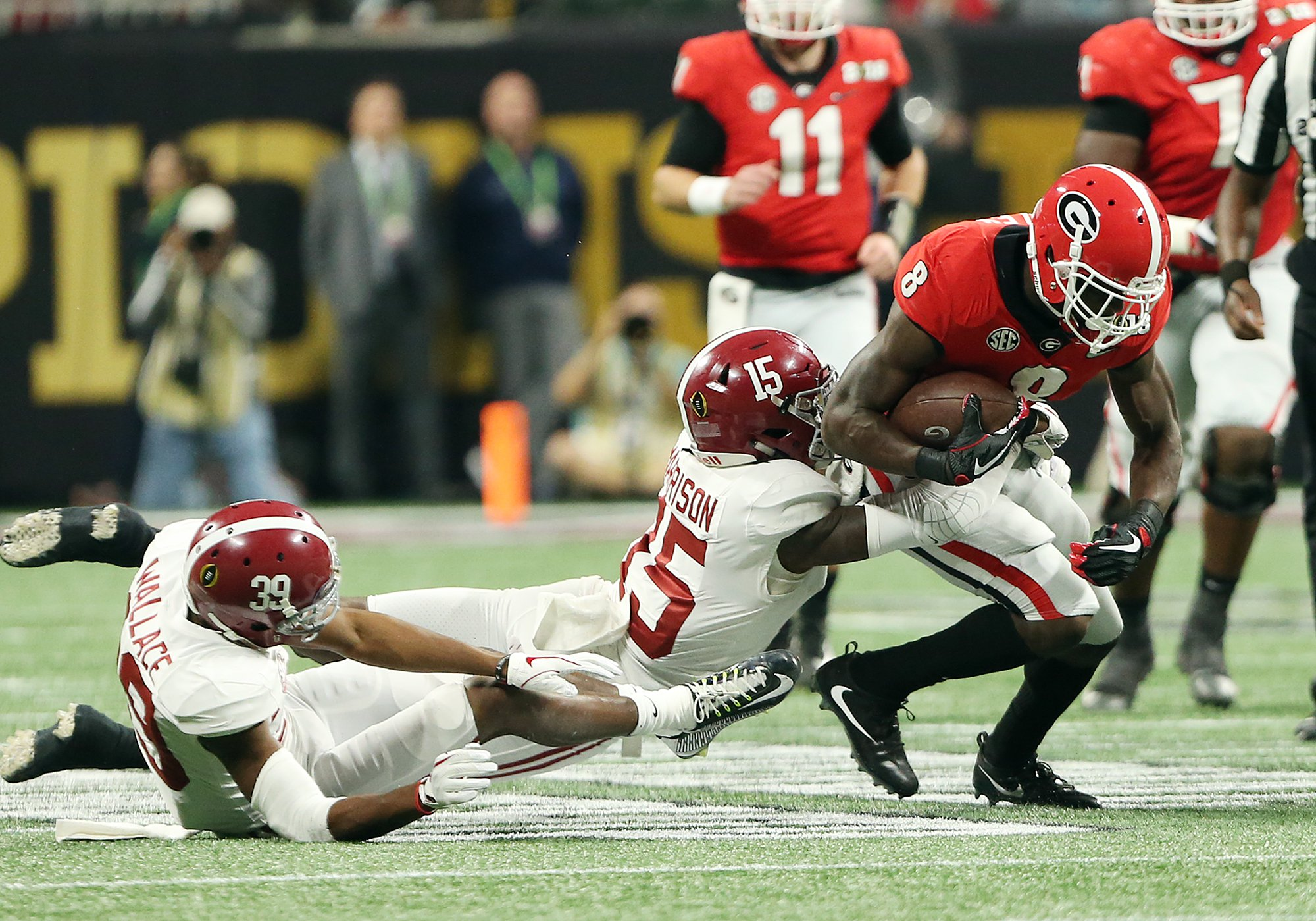 Alabama's Ronnie Harrison tackles Georgia's Riley Ridley after a catch