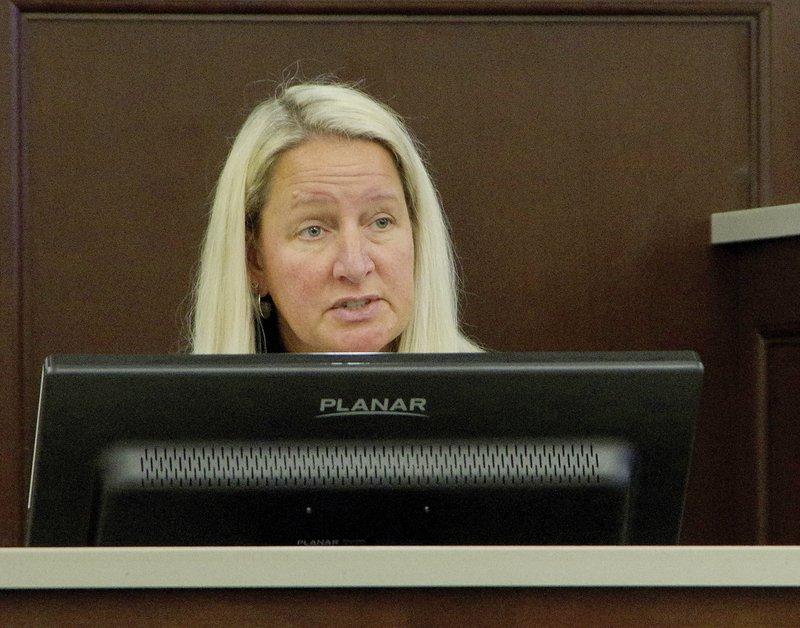 Michelle Root testifies.jpg